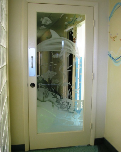 Etched door at the office of pediatric dentist Dr. John Bazos in Coral Springs, FL